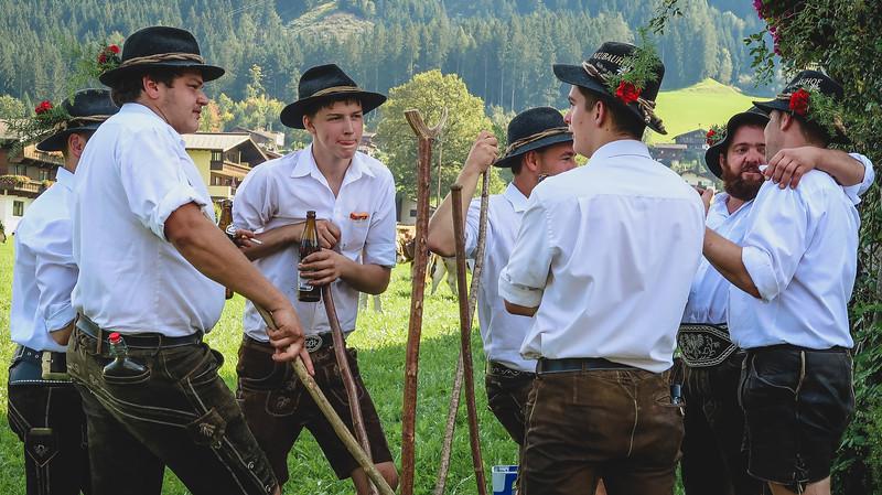 Local men dress up in lederhosen for the Almabtrieb
