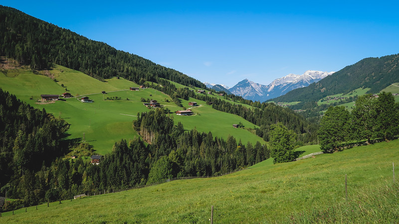 Green valleys and snowcapped mountains in Tirol