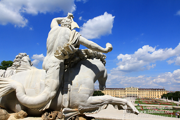 Statue of Neptunes entourage - a Triton creature (half-man, half-fish) rides a horse above the Neptune Fountain at Schloss Schoenbrunn