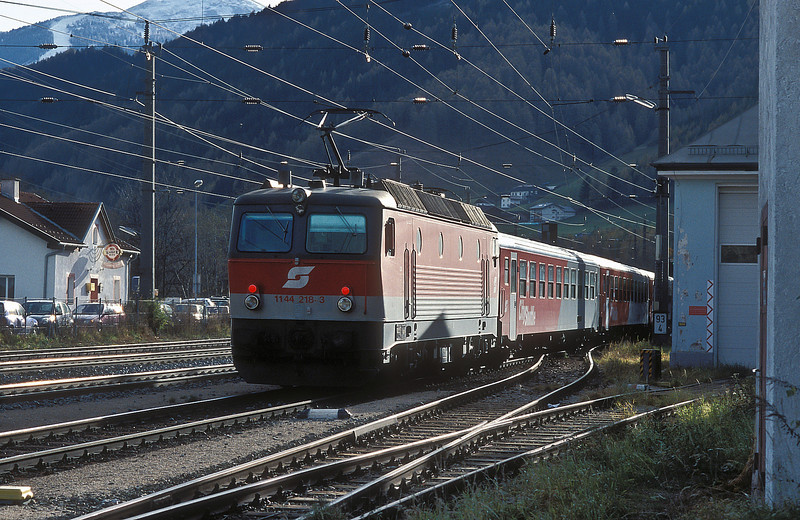 The last rays of the afternoon sun are about to disappear behind the mountains as OBB 1144.218 leaves Matrei with the local passenger service for Brenner on 13 November 2006