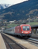 OBB 1116.180 blasts up the north-ramp of Brenner through Matrei on 13 November 2006 with one of the hourly expresses through to Italy
