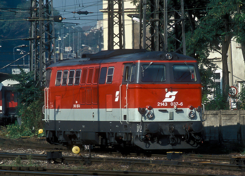 The 'Hercules' locos are rapidly taking over many of the diesel turns but the older locos still survive in places - OBB 2143.037 is at Bratislava Hlavna Stanica with a passenger service on 11 October 2007; it is seen running round the coaching stock