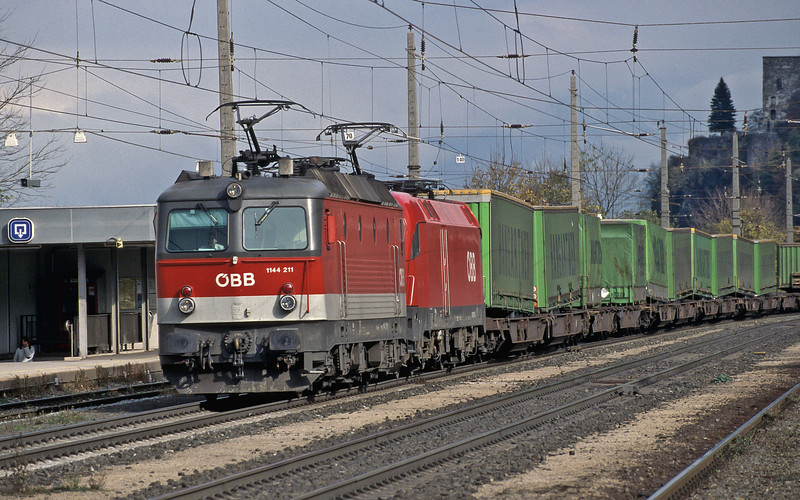 OBB 1144.211 and 1016.021 head a train of curtain-sided trailers from Germany through Brixlegg on 28 October 2008
