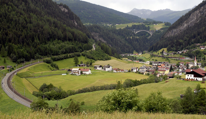 St Jodok horseshoe, 29 June 2006 1.   Looking west.  The line climbs from Innsbruck (right) towards the Brenner Pass (left).  The distant bridge carries the Brenner motorway.