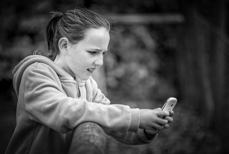 Granddaughter & Phone at Exmoor Zoo in Mono.