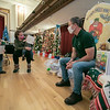 Author J. Anthony Garreffi of Lancaster reads one of his books to some families at this years Festival of Lights at Leominster City Hall last week. SENTINEL & ENTERPRISE/JOHN LOVE