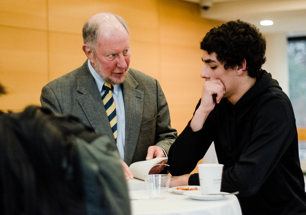 . Robert Putnam, author of \'Our Kids: The American Dream in Crisis\', signs a copy of his book for Gonzalo Arbiza, a student from Westminster, at Fitchburg State University during the keynote lecture as part of the Community Reads program on Tuesday, April 4, 2017. SENTINEL & ENTERPRISE / Ashley Green