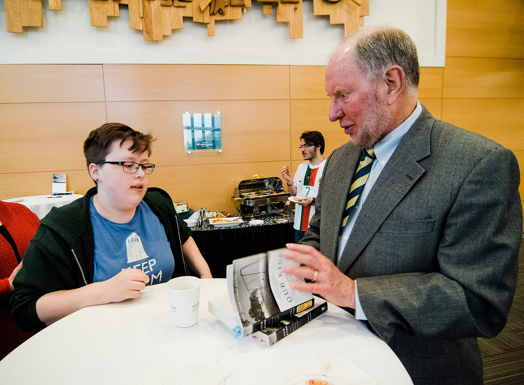 . Robert Putnam, author of \'Our Kids: The American Dream in Crisis\', signs a copy of his book for Heather Ferguson, a student from Chelmsford, at Fitchburg State University during the keynote lecture as part of the Community Reads program on Tuesday, April 4, 2017. SENTINEL & ENTERPRISE / Ashley Green