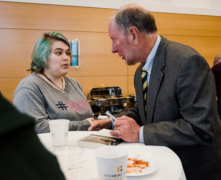 . Robert Putnam, author of \'Our Kids: The American Dream in Crisis\', signs a copy of his book for Jocelyn Cormier, a student from Athol, at Fitchburg State University during the keynote lecture as part of the Community Reads program on Tuesday, April 4, 2017. SENTINEL & ENTERPRISE / Ashley Green