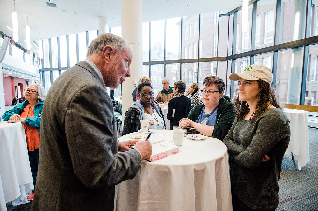 . Robert Putnam, author of \'Our Kids: The American Dream in Crisis\', signs copies of his book for students and faculty at Fitchburg State University during the keynote lecture as part of the Community Reads program on Tuesday, April 4, 2017. SENTINEL & ENTERPRISE / Ashley Green