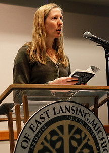 "Author Bonnie Jo Campbell reads from her book, ""American Salvage"" during a program on methamphetamine in East Lansing, Mich., on Jan. 26, 2012. Other panel members included Lt. Tony Saucedo, head of the Michigan State Police Methamphetamine Task Force, Steve Rachman, from the Michigan State University Department of English, Joyce Pines, of the Jim Gilmore, Jr., Community Healing Center and Jim Galligan, a Michigan State University neuroscientist. The Michigan State University event was part of their community conversations series on Fiction & Michigan's public concerns at the Hannah Community Center in East Lansing. (Photo by Bradley S. Pines / contact: bspines@gmail.com)"