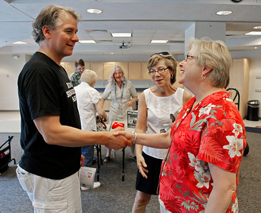 """Author Bryan Gruley chats with fans before beginning his speach. Gruley visited the Portage District Library to read and sign his recently published """"The Skeleton Box,"""" the latest of his Starvation Lake novels, on July 14, 2012.  Gruley, now at Business Week, had worked as a reporter at the Kalamazoo Gazette earlier in his career. (Courtesy of Bradley S. Pines / BSPines@gmail.com)"""