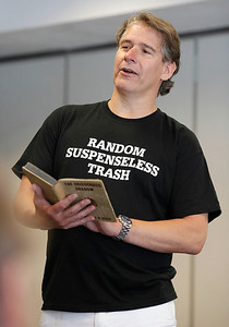 """Author Bryan Gruley reads from """"The Crisscross Shadow"""" by Franklin W. Dixon. He says this Hardy Boys mystery, purchased for him by his mother, may have inspired his career as a novelist. Gruley visited the Portage District Library to read and sign his recently published """"The Skeleton Box,"""" the latest of his Starvation Lake novels, on July 14, 2012.  Gruley, now at Business Week, had worked as a reporter at the Kalamazoo Gazette earlier in his career. (Courtesy of Bradley S. Pines / BSPines@gmail.com)"""