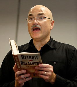 """Author Dan Johnson reads from his third historical mystery, """"Detroit Breakdown"""" during a visit to the Portage, Michigan District Library for a talk on the release day of the book, Sept. 4, 2012.  (Bradley S. Pines /  bspines@gmail.com)"""