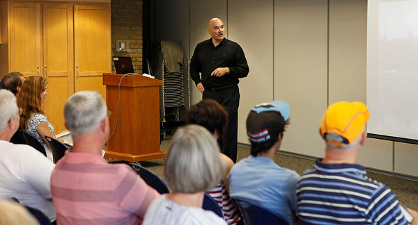 """Author Dan Johnson talks about his third historical mystery, """"Detroit Breakdown,"""" during a visit to the Portage, Michigan District Library for a talk on the release day of the book, Sept. 4, 2012.  (Bradley S. Pines /  bspines@gmail.com)"""