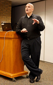 """Author Dan Johnson chats with the audience about his third historical mystery, """"Detroit Breakdown"""" during a visit to the Portage, Michigan District Library for a talk on the release day of the book, Sept. 4, 2012.  (Bradley S. Pines /  bspines@gmail.com)"""