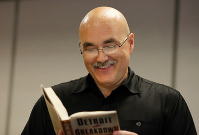 """Author Dan Johnson smiles as he reads from his third historical mystery, """"Detroit Breakdown,"""" during a visit to the Portage, Michigan District Library for a talk on the release day of the book, Sept. 4, 2012.  (Bradley S. Pines /  bspines@gmail.com)"""