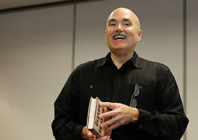 """Author Dan Johnson smiles before reading from his third historical mystery, """"Detroit Breakdown,"""" during a visit to the Portage, Michigan District Library for a talk on the release day of the book, Sept. 4, 2012.  (Bradley S. Pines /  bspines@gmail.com)"""