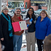 From left to right; Sue Loring, Fitchburg Mayor Stephen DiNatale, and members of the FItchburg Disability Commission Sheela Vadrevu and Kathy Hamelin pose with the document that declares April 2, 2017 Autism Awareness Day in Fitchburg.  (Sentinel & Enterprise photo/Jeff Porter)