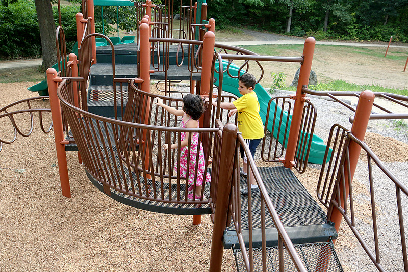 Mikaela Hernadez, 6, and her brother Jaedin, 9, who are both autistic, play at the playground at Barrett Park on Thursday afternoon. SENTINEL & ENTERPRISE/JOHN LOVE