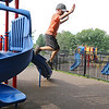 Nicholas Maillet runs around playing at the Southeast playground on Thursday afternoon. Nicholas, who lives with autism, seems to not be afraid to jump off the side of the slide at the playground. SENTINEL & ENTERPRISE/JOHN LOVE