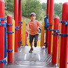 Nicholas Maillet runs around playing at the Southeast playground on Thursday afternoon. Nicholas has Autism. SENTINEL & ENTERPRISE/JOHN LOVE