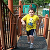 Jaedin, 9 who is autistic,runs around the playground during his visited to Barrett Park on Thursday afternoon. SENTINBEL & ENTERPRISE/JOHN LOVE