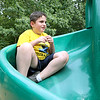 Jaedin, 9 who is autistic, plays on the slide during his visited to Barrett Park on Thursday afternoon. SENTINBEL & ENTERPRISE/JOHN LOVE