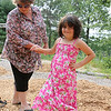 Mikaela Hernadez, 6 who is autistic, is all smiles as she stands with her grandmother Debra Phillips during their visit to Barrett Park on Thursday afternoon. SENTINEL & ENTERPRISE/JOHN LOVE