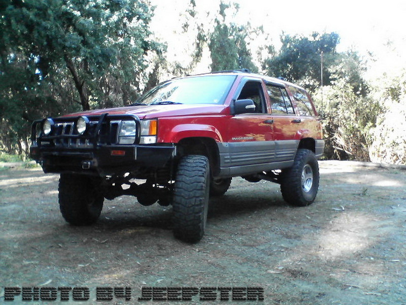 "(JEEP #5) Meet HellBilly. 1998 Jeep Grand Cherokee w/6"" Rock Crawler Kit, Detachable anti Swaybars, Bilstien Shocks, 35"" Pro Comp X-Terrain Tires, 4.0 inline 6 cyl, ARB Bull Bar, 456 Gear ratio w/Detroit True Track Lockers, Zenon HID lights, 6 Disk CD changer, 2 12"" subs w/1000 watt amp.<br /> <br /> Has been in 2 head-on collisions and 1 pedestrian run-over. 3 wins, 0 losses!"