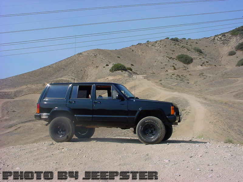 """(Jeep #1) Meet Grandpa... 1984 Jeep Cherokee with 4"""" Milatary Style Lift, 33"""" all terain tires, 4.0L 6 cyl, 2 18"""" subs.<br /> <br /> 1 pedestrian run over, 2 head-on collisions (one of them with multiple casualties.) 2 wins 0 losses"""