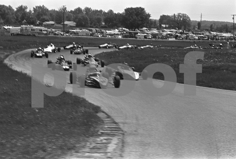At this point the cars are entering Waterford Bend as they climp up to Hilltop. The cornerworkers at Turn 3 are just visible at the right edge of this image.