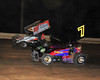 "Ed Aiken was the highest finishing 360 sprinter during Bridgeport Speedway's ""Night of Wings"".  He battles here with overall winner Lance Dewease.  This photo appeared in the June 26th edition of Area Auto Racing News."