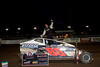 This reprint of Ryan Godown celebrating victory in Bridgeport Speedway's season opener was published in the October 2nd. edition of Area Auto Racing News along with an article about Ryan.