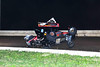 Steph Palmai and Ed Newhouser tangle during the final TSRS race at Bridgeport Speedway.  This photo appeared in the November 13th edition of Area Auto Racing News.