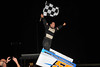 Jack Conover celebrates his victory in the Bill Thomas Memorial 600cc feature.  This photo appeared on the October 9th. edition of Area Auto Racing News.