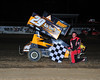 Bill Thomas visits Victory Lane again in the 600 Micro class at Bridgeport on July 12th.  This photo appeared in the July 17th edition of AARN.