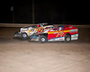 Tommy Beamer gets by Travis Hill with a controversial turn four pass on the last lap to win the Crate feature at Bridgeport Speedway on August 7th.  This picture appeared in the August 7th edition of AARN.