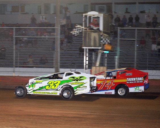 Matt Budd gets Tommy Beamer at the line.  This photo appeared in the June 5th edition of AARN.