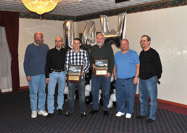 This January 14th photo was taken at the Roberts/Watt championship party held in honor of their 2011 championship at Bridgeport Speedway.  It appeared in the January 17th edition of Area Auto Racing News.