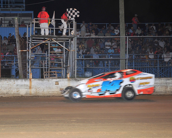 This July 2011 photo of Ron Roberts taking the checked flag at Georgetown Speedway accompanied a Brett Deyo article regarding the reopening of Georgetown for special shows late in 2012.  It appeared in the July 31, edition of AARN.