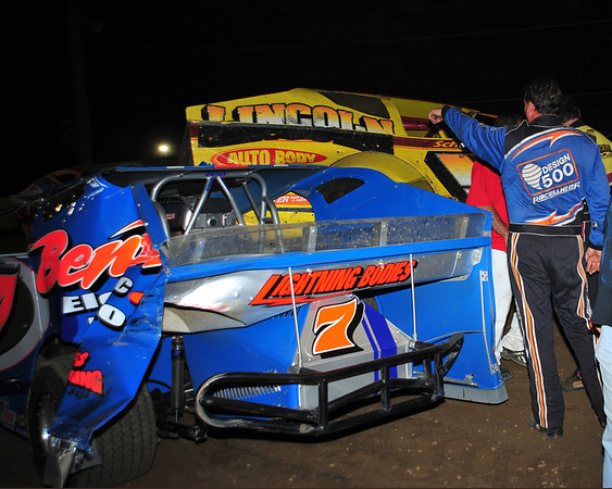 Rick Lauback and Jimmy Horton are part of a major pile-up in the early stages of the Big Block feature at Bridgeport Speedway on June 23rd.  Lauback came back to win the feature.  This photo appeared in the June 26th edition of Area Auto Racing News.