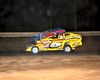 After being involved in a big wreck, Rick Lauback and Jimmy Horton return and battle for the lead.This photo appeared in the June 26th edition of Area Auto Racing News.