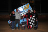 Richie Keller celebrates his victory in the Bill Thomas Memorial 270cc feature with his parents and brother Jon.  This photo appeared on the October 9th. edition of Area Auto Racing News.