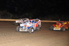Bridgeport Crate champion Ryan Anderson takes the high route to victory at New Egypt Speedway on October 13th.  This photo appeared in the October 16th edition of Area Auto Racing News.