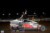 Ryan Godown celebrates in Bridgeport Speedway Victory Lane after taking the 2012 season opener.  This photo appeared in the April 3rd<br />  edition of Area Auto Racing News.