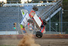 Ernie Miles takes a wild ride while qualifying for the Bill Thomas Memorial October 6th. at Bridgeport Speedway.  This photo appeared on the October 9th. edition of Area Auto Racing News.