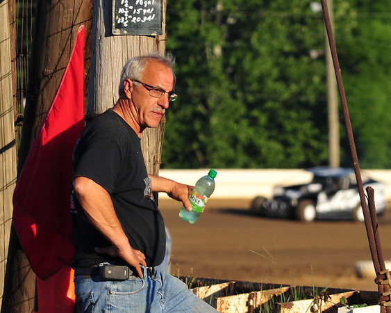 """Doug Hoffman looks over the track prior to the start of the """"Tom Hagar Remembered"""" race on July 24th.  This photo appeared in the July 31 edition of AARN."""