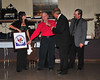 Modified driver Ed Firth presents Bridgeport promoters Doug and Gena Hoffman with a plaque commemorating Bridgeport Speedway's 40th anniversary.  This photo appeared in the December 11th edition of Area Auto Racing News.