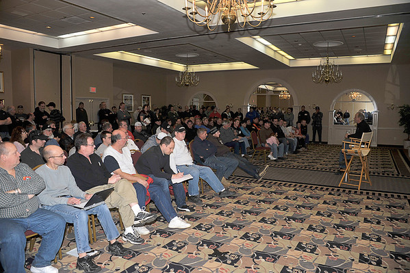 Doug Hoffman speaks to the Saturday night drivers at a pre-season meeting outlining his plans for Bridgeport Speedway in 2012.  This photo appeared in the January 31 edition of Area Auto Racing News.